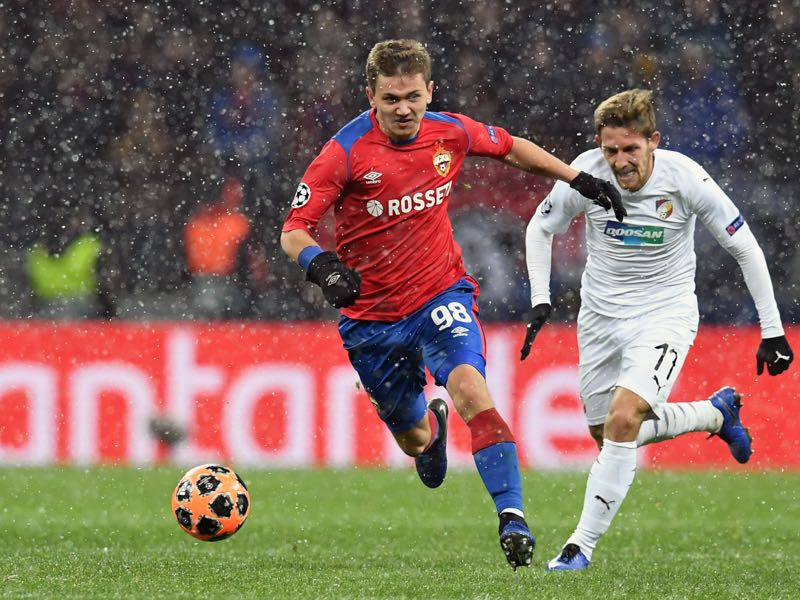 CSKA Moscow's Russian midfielder Ivan Oblyakov and Viktoria Plzen's Slovak midfielder Patrik Hrosovsky vie for the ball during the UEFA Champions League group G football match between PFC CSKA Moscow and FC Viktoria Plzen at the Luzhniki stadium in Moscow on November 27, 2018. (Photo by Yuri KADOBNOV / AFP)