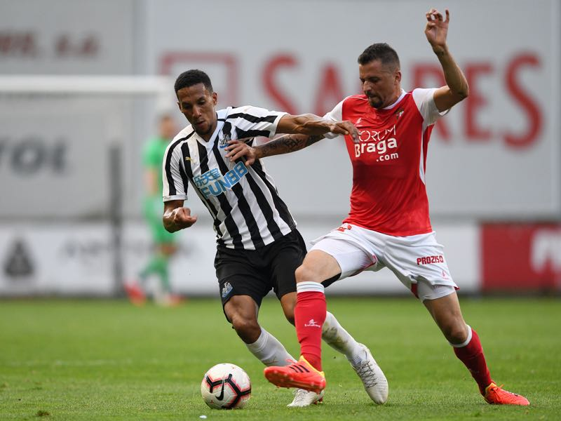 Claudemir of SC Braga competes for the ball with Isaac Hayden of Newcastle during the Pre-season friendly between SC Braga and Newcastle on August 1, 2018 in Braga, Portugal. (Photo by Octavio Passos/Getty Images)