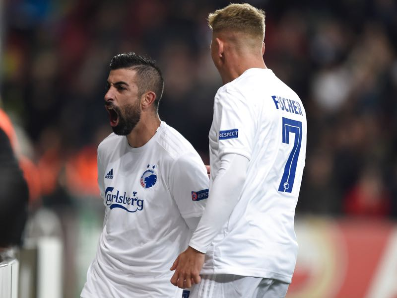 FC Copenhagen's Michael Santos (L) celebrates scoring a goal with teammate Viktor Fischer during the UEFA Europa League Group B football match FC Copenhagen v FC Lugano in Copenhagen, Denmark, on September 19, 2019. (Photo by Liselotte Sabroe / Ritzau Scanpix / AFP)