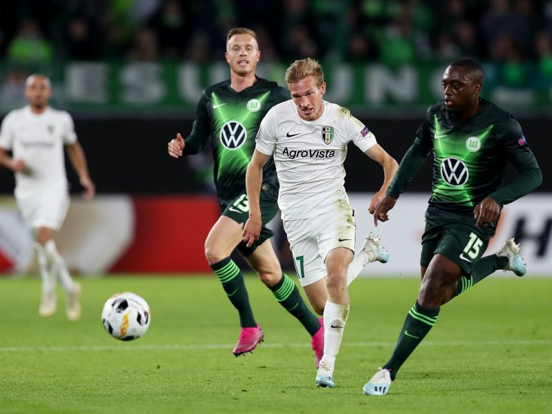Valeriy Luchkevych of Oleksandriya challenges for the ball with Jerome Roussillon of VfL Wolfsburg during the UEFA Europa League group I match between VfL Wolfsburg and FC Oleksandriya at Volkswagen Arena on September 19, 2019 in Wolfsburg, Germany. (Photo by Maja Hitij/Bongarts/Getty Images )