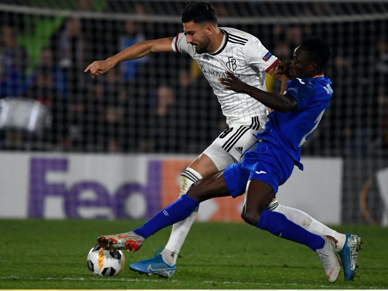 FC Basel's Swiss forward Kemal Ademi (L) vies with Getafe's Togolese defender Djene during the UEFA Europa League group D football match between Getafe CF and FC Basel at the Col. Alfonso Perez stadium in Getafe on October 24, 2019. (Photo by PIERRE-PHILIPPE MARCOU / AFP)
