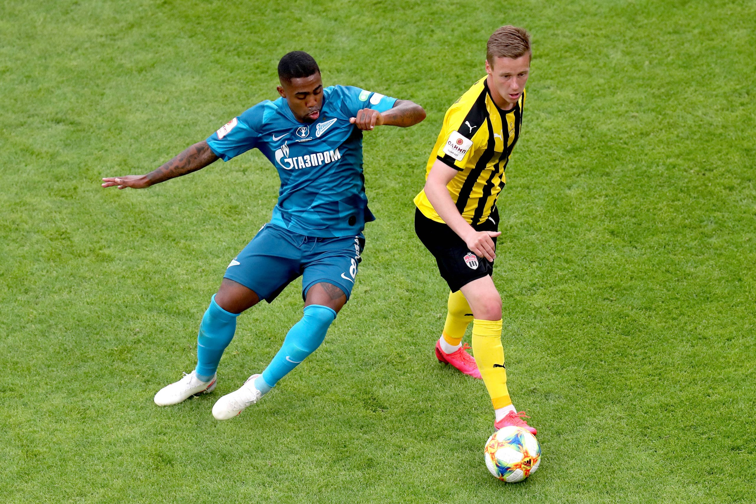 Zenit vs Khimki - YEKATERINBURG, RUSSIA - JULY 25, 2020: Zenit St Petersburg s Malcom L and FC Khimki s Maxim Martusevich are in action in their 2019/2020 Russian Cup final football match at Yekaterinburg Arena. Donat Sorokin/TASS PUBLICATIONxINxGERxAUTxONLY TS0E135D