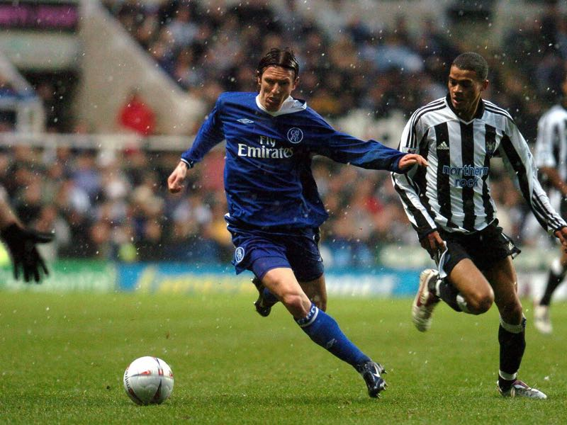 Chelsea's Smertin (l) and Newcastle's Kieron Dyer(r) fight for the ball during their FA Cup clash at St James' Park Newcastle 20 February 2005. AFP PHOTO PAUL BARKER (Photo credit should read PAUL BARKER/AFP/Getty Images)