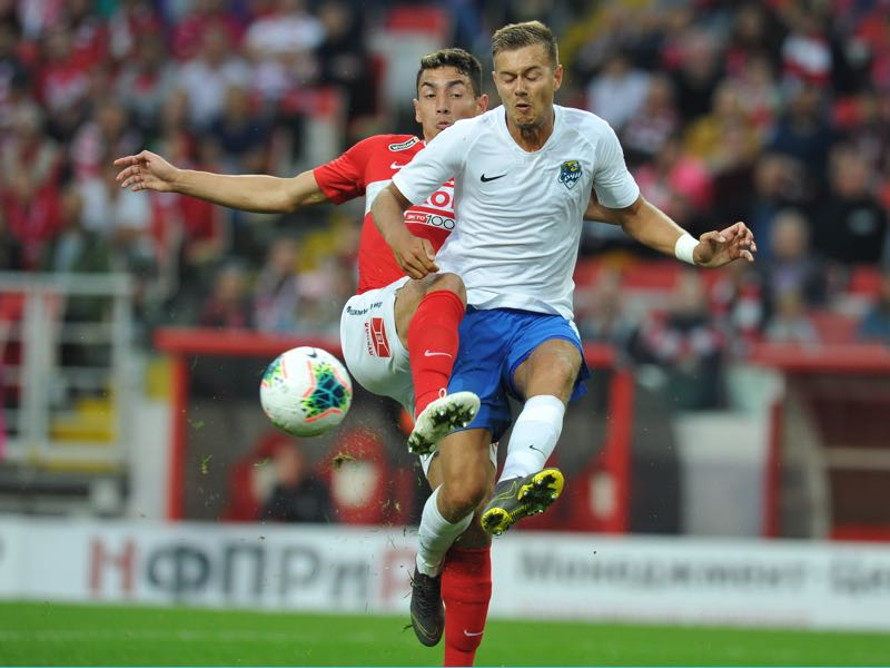 Ezequiel Ponce of FC Spartak Moscow and Timofey Margasov of PFC Sochi vie for the ball during the Russian Premier Liga match between FC Spartak Moscow and PFC Sochi on July 13, 2019 in Moscow, Russia. (Photo by Epsilon/Getty Images)
