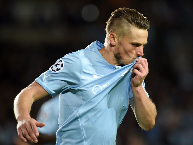 Markus Rosenber of Malmo celebrates after scoring the opening goal during UEFA Champions League qualifying play-offs round second leg match between Malmo FF and Red Bull Salzburg on August 27, 2014 in Malmo, Sweden. (Photo by Giuseppe Bellini/Getty Images)