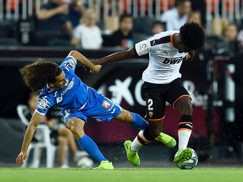 Getafe's Spanish midfielder Marc Cucurella vies with Valencia's Portuguese defender Thierry Correia during the Spanish league football match between Valencia CF and Getafe CF at the Mestalla stadium in Valencia, on September 25, 2019. (Photo by JOSE JORDAN / AFP)