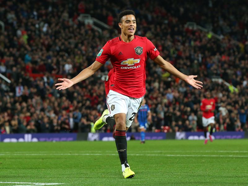 Mason Greenwood of Manchester United celebrates scoring his teams first goal of the game during the Carabao Cup Third Round match between Manchester United and Rochdale at Old Trafford on September 25, 2019 in Manchester, England. (Photo by Alex Livesey/Getty Images)