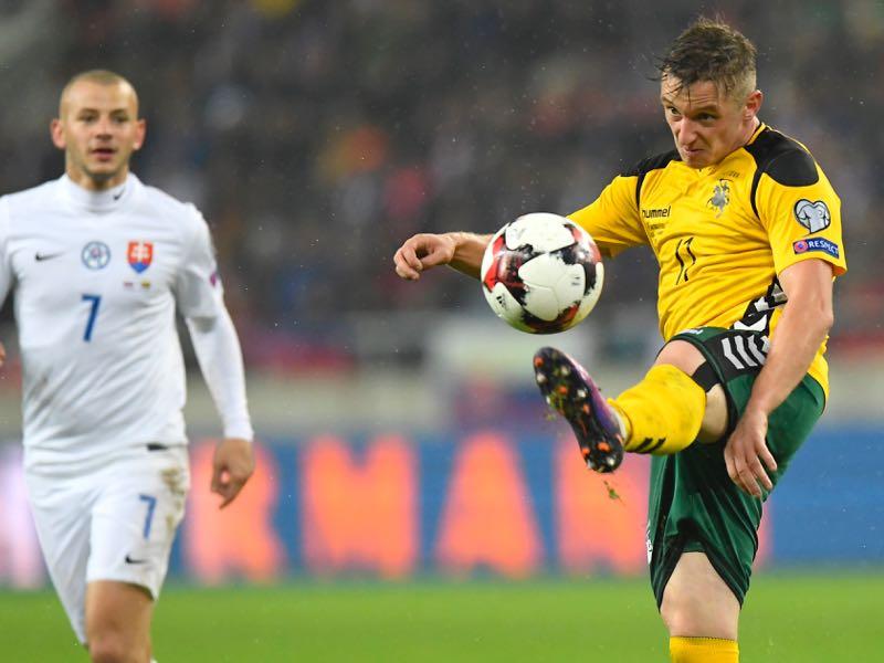Lithuania's Arvydas Novikovas kicks the ball during the World Cup 2018 qualification football match between Slovakia and Lithuania in Trnava, Slovakia on November 11, 2016. / AFP / JOE KLAMAR