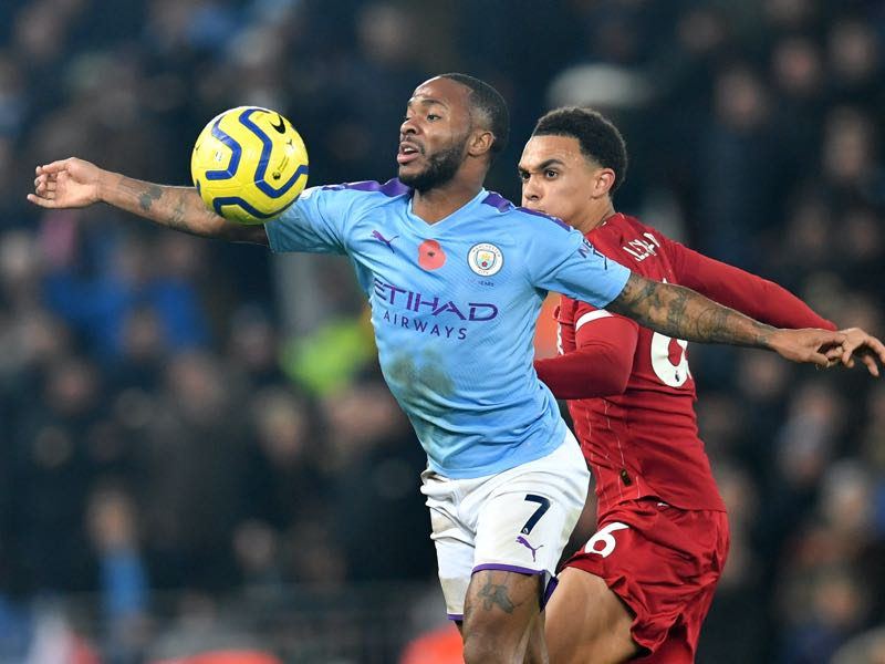 Manchester City's English midfielder Raheem Sterling (L) vies with Liverpool's English defender Trent Alexander-Arnold (R) during the English Premier League football match between Liverpool and Manchester City at Anfield in Liverpool, north west England on November 10, 2019. (Photo by Paul ELLIS / AFP)