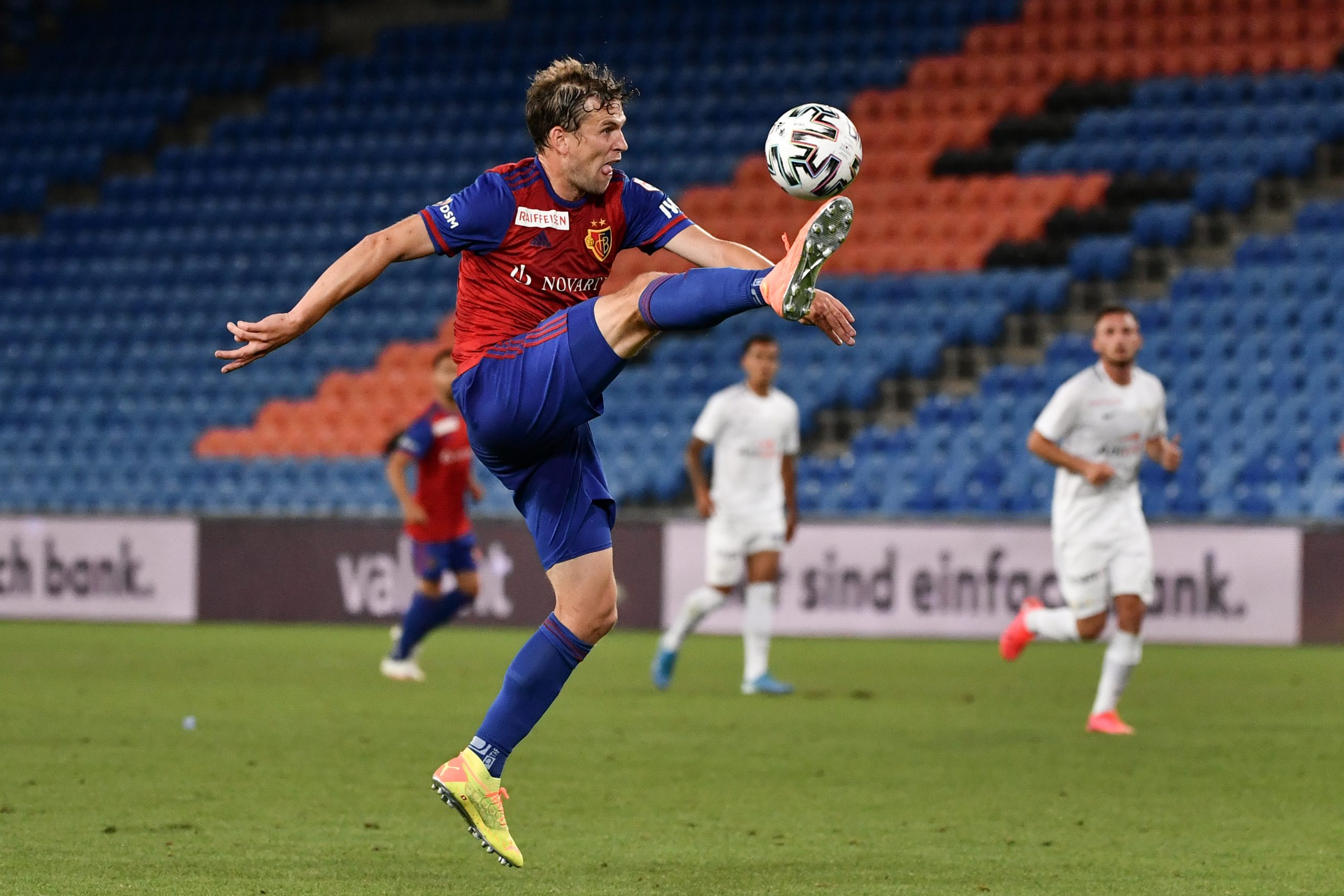 FC Basel's Swiss midfielder Fabian Frei controls the ball during the Swiss Super League football match between FC Basel and FC Zurich played with its U21 team as part of its first-team squad was placed under lockdown after six players and three staff members have been tested positive to the COVID-19, on July 14, 2020 in Basel. (Photo by Fabrice COFFRINI / AFP) (Photo by FABRICE COFFRINI/AFP via Getty Images)